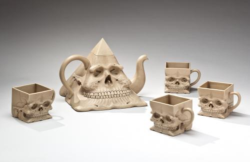RICHARD NOTKIN, PYRAMIDAL SKULL TEAPOT AND CUPS